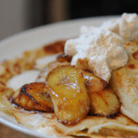 Warm Banana and Maple Syrup Pancakes with Cinnamon Cream